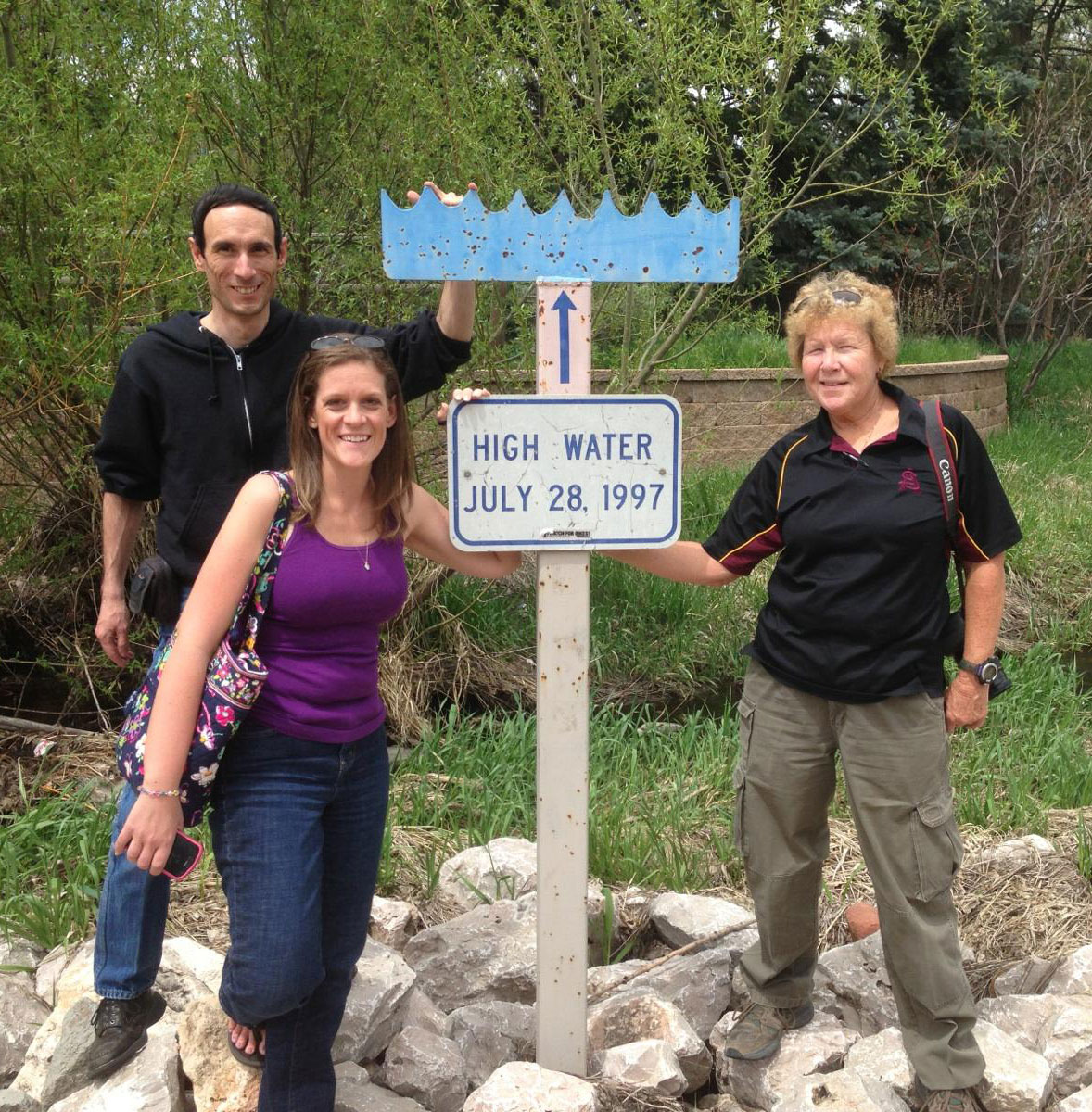 CoCoRaHS coordinators Tony (WY), Melissa (FL), and Nancy (AZ) at a high water mark for the 1997 Fort Collins, Colorado, flood.